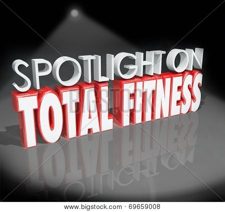 Spotlight on Total Fitness words in 3d letters looking at healthy lifestyles with diet and exercise