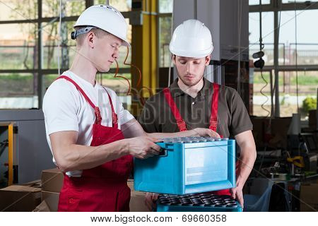 Engineers During Working In A Factory