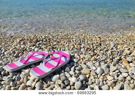 Flip flops on pebbled beach closeup Vassiliki Lefkada