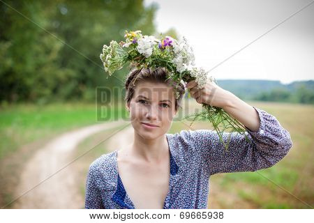 Young Woman With Wild Flowers