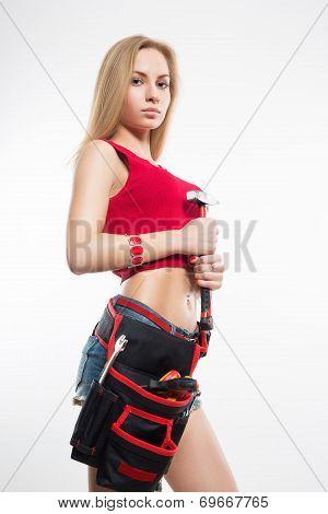 girl. keeps working tools. hammer