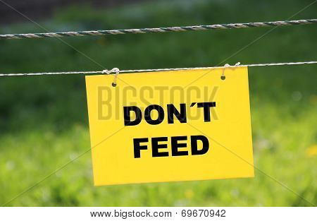 Pasture Ground With Electrical Fence And Prohibition Sign - Dont Feed