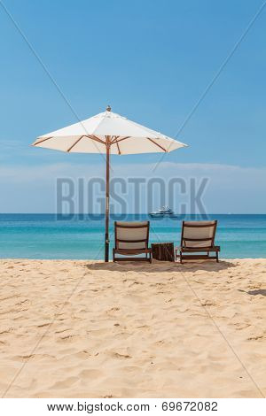 Sunbeds and umbrella on Freedom beach Koh Phuket in Thailand