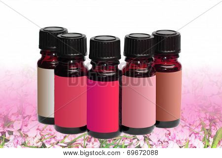 Five Phials Unlabeled On Cherry Blossom Background
