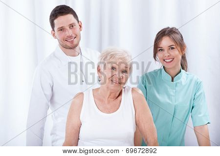 Geriatric Patient With Her Physiotherapists