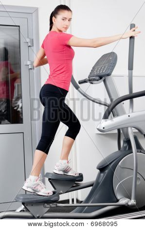 Woman On A Training Simulator
