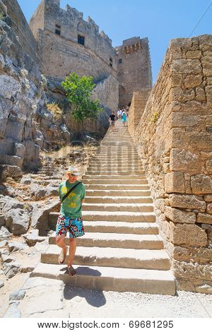 Unidentified Tourists Walking In Historic Town Lindos