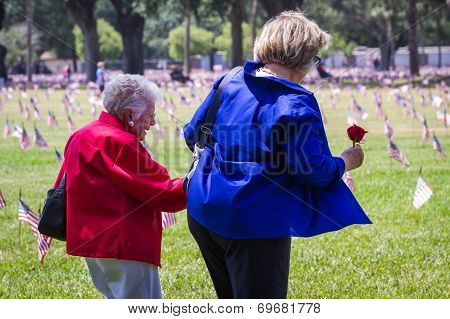 Family Members Visiting The Cemetery On Memorial Day
