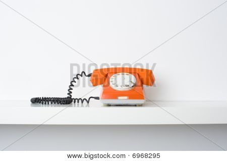Red Telephone On Shelf
