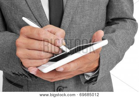 a businessman using a stylus pen in his tablet