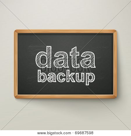 Data Backup On Blackboard In Wooden Frame