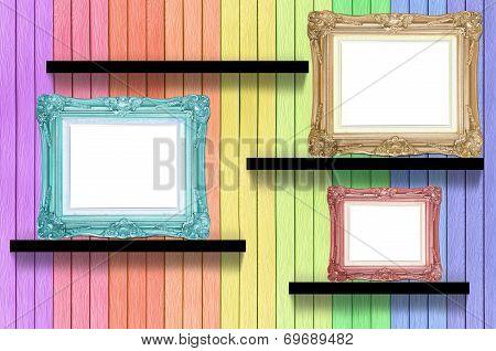 Antique Frame On Colorful Wood Shelf On Wood