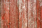 stock photo of red barn  - A background of old red barnwood with peeling paint on the exterior of a barn - JPG