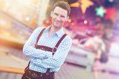 image of lederhosen  - Handsome guy wearing Bavarian Lederhosen trousers with his arms folded - JPG