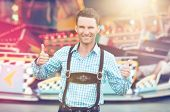 pic of lederhosen  - Beautiful man wearing traditional Bavarian Lederhosen doing thumbs up - JPG