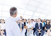 stock photo of training room  - Businessman giving presentation to his Colleagues - JPG
