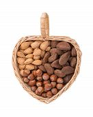 foto of brazil nut  - Variety of nuts with almonds hazelnuts and Brazil nuts in heart shape basket isolated on white - JPG