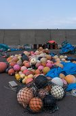 pic of tarp  - Plastic fishing floats in a port - JPG