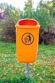 picture of dust-bin  - Orange plastic dust bin in the park - JPG