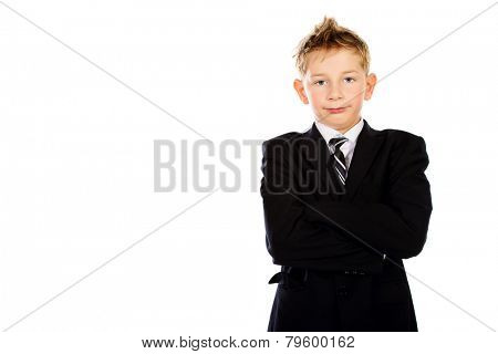 Portrait of a cute serious boy in black suit. Education. Isolated over white.