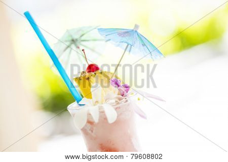 Fruity Tropical Drink with Pineapple and Umbrellas at the Bar.