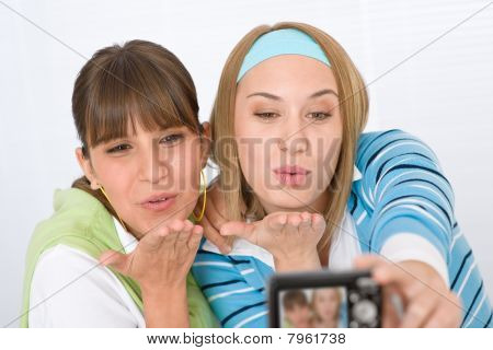 Two Young Woman Taking Picture