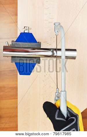 Metalworker Sawing Trap Pipe Gripped In Vice