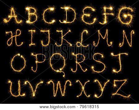Spark alphabet over black background