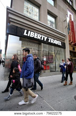 NEW YORK CITY - MONDAY, DEC. 29, 2014: Pedestrians walk past a Liberty Travel agent. Liberty Travel is an American retail travel and cruise company owned by Flight Centre Ltd.