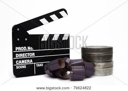 Movie Clapper Board And 35Mm Film On White Background