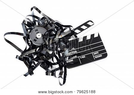 Movie Clapper Board With Video Tape On White Background
