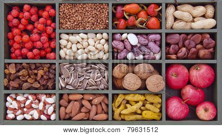 Various Vegetarian Healthy Fruits And Seeds In Wooden Box