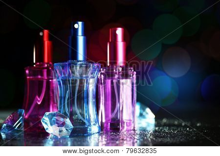 Women's perfume in beautiful bottles on dark background