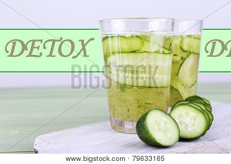 Glasses of cucumber cocktail on cutting board on wooden table, Detox concept