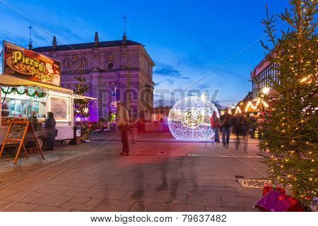 GDANSK, POLAND - DECEMBER 17, 2014: Christmas decorations on the old town of Gdansk at night, Poland. Gdansk is the historical capital of Polish Pomerania with medieval old town architecture.