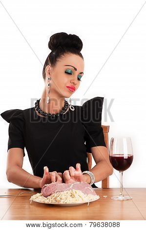 woman with disgust holding a piece of raw meat