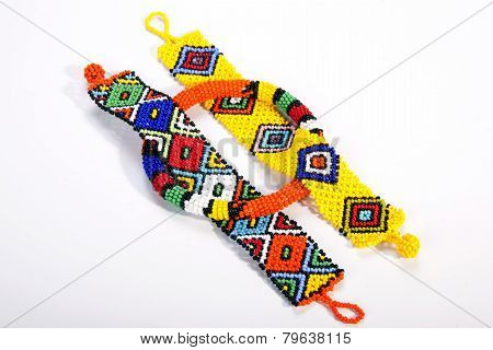 Three Pieces Of Brightly Colored Beaded Zulu Jewelry