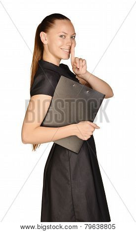 Business beautiful girl holding paper holder and forefinger finger to lips.