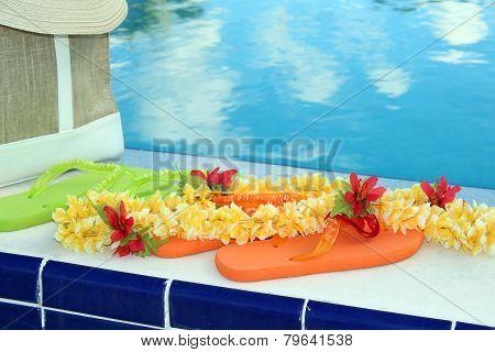 Flip flops by the pool edge
