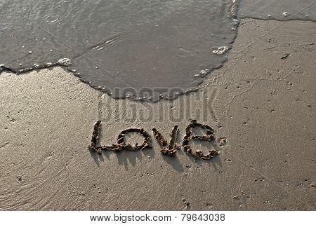 'love' Text Written On The Beach