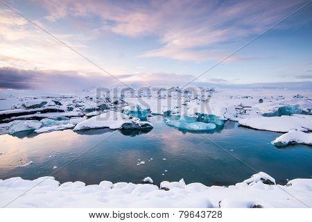 Beautiful blue lagoon with plenty of floating ice on the Jokulsaron lagoon, Iceland