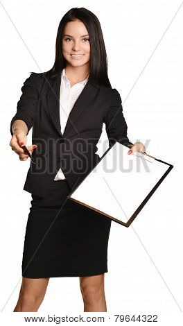 Beautiful girl takes the pen to sign a paper holder.