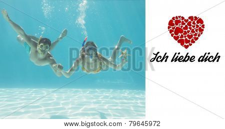Cute couple underwater in the swimming pool with snorkel and starfish against ich liebe dich