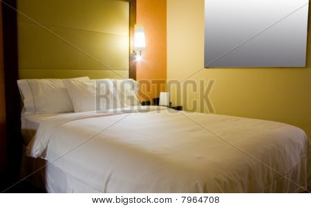 King-size bed with bedside table and lamp