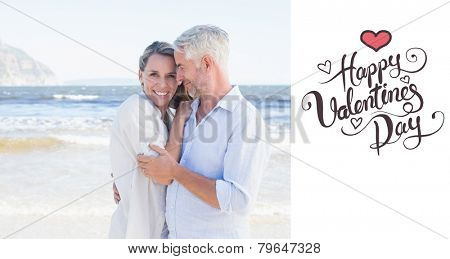 Happy couple hugging on the beach woman looking at camera against happy valentines day
