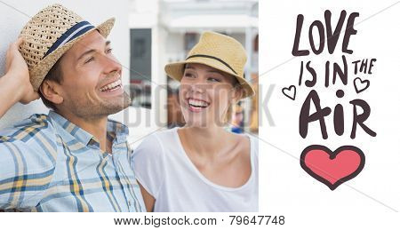 Young hip couple sitting on bench against love is in the air