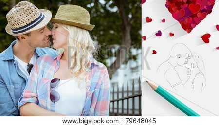 Hip young couple kissing by railings against sketch of kissing couple with pencil