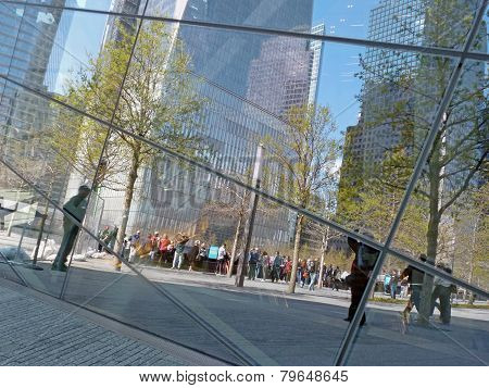 Tourists reflected in September 11 Memorial Museum