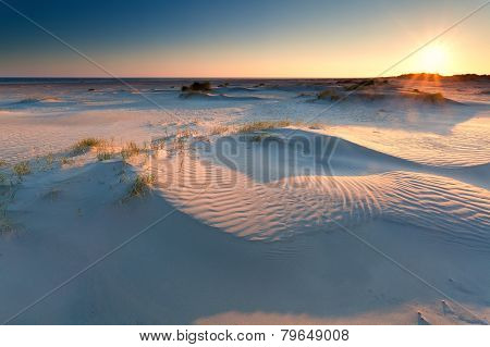 Sunrise Over Sand Dunes On North Sea Beach