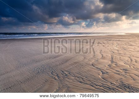 Sunrise Over North Sea Sand Beach